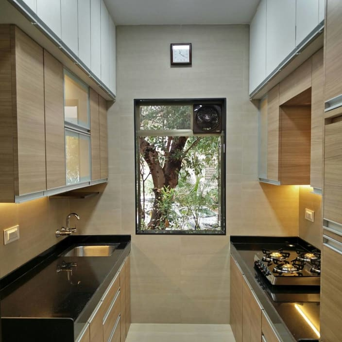 Modern Interior Design Review: Small Parallel Kitchen With Wooden Cabinets By Mitul Shah