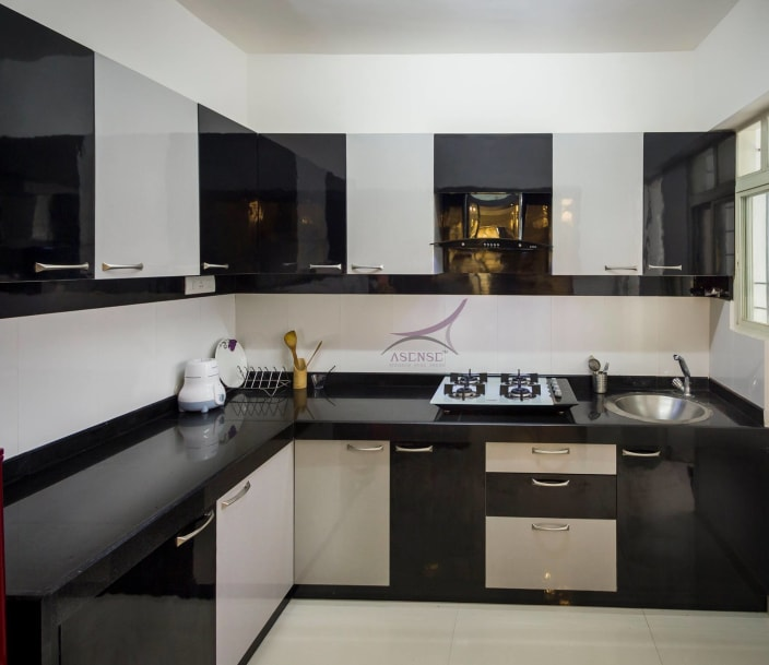 Black And White Themed Modular Kitchen By Snigdha Ghosh