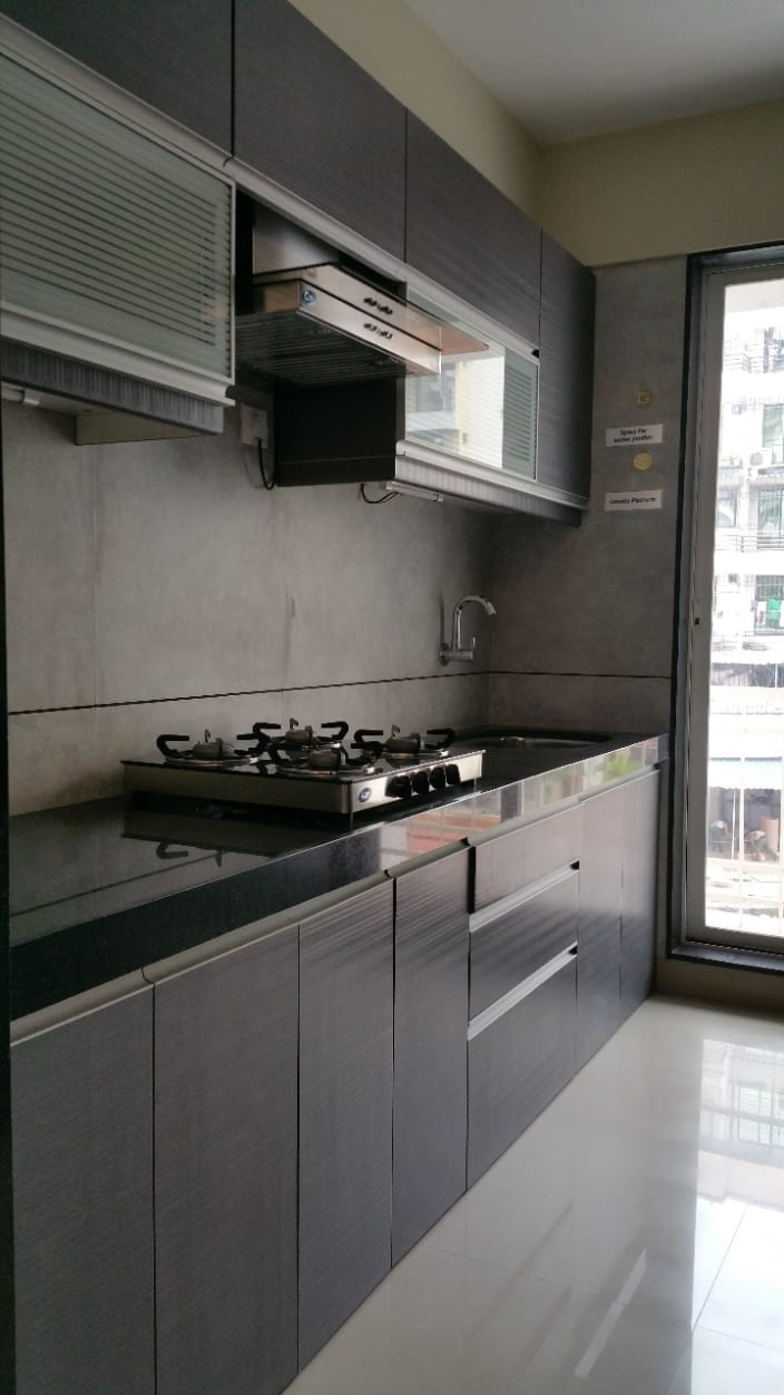 Parallel Kitchen With Wooden Base And Wall Cabinets And Black Granite Counter Top By Alaya D Decor