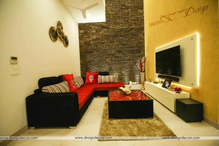L Shaped Sofa With Wall Art In Living Room By Design Decor