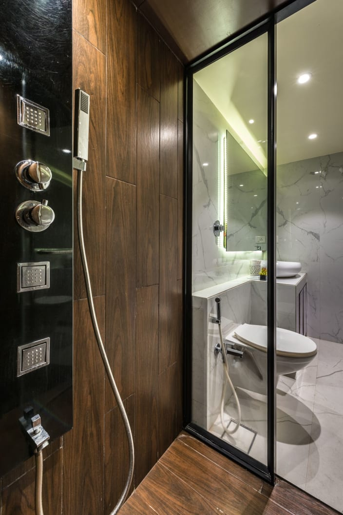 Sleek Modern Bathroom With Hardwood Shower Cubical And White Glossy Fittings