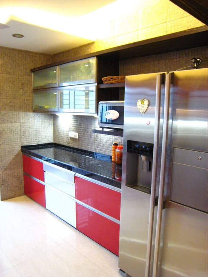 Modular Kitchen With Red And White Cabinets And Black Counter Top