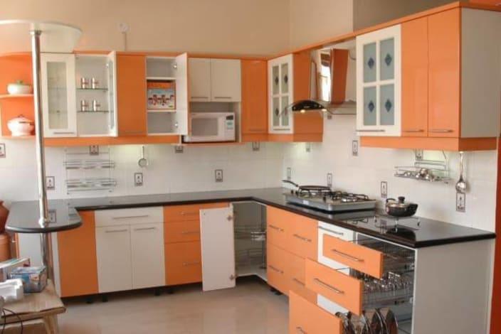Orange And White Themed Modular Kitchen By Vjp Decors