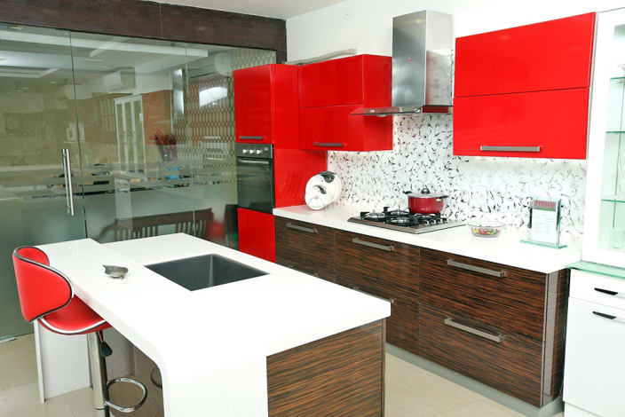 Open Island Kitchen With Red Cabinets