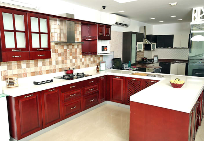 U Shaped Kitchen With False Ceiling And Maroon Cabinets