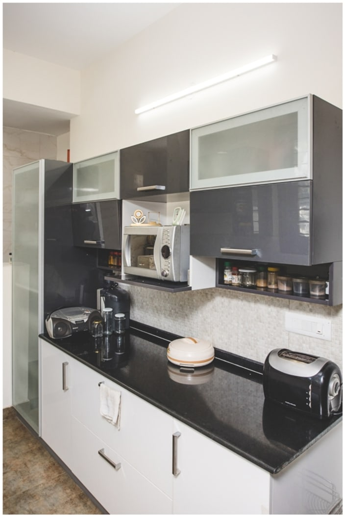 White Kitchen Cabinets With Black Marble Counter Top By Shyama Viswanathan