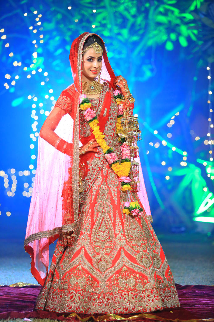 a6b2849f26 Bride Wearing an Exquisite Crimson Red Lehenga With Gota Patti Work