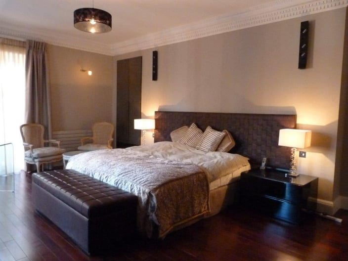 King Size Bed With Wood Flooring And Black Bedroom Bench By Mayank