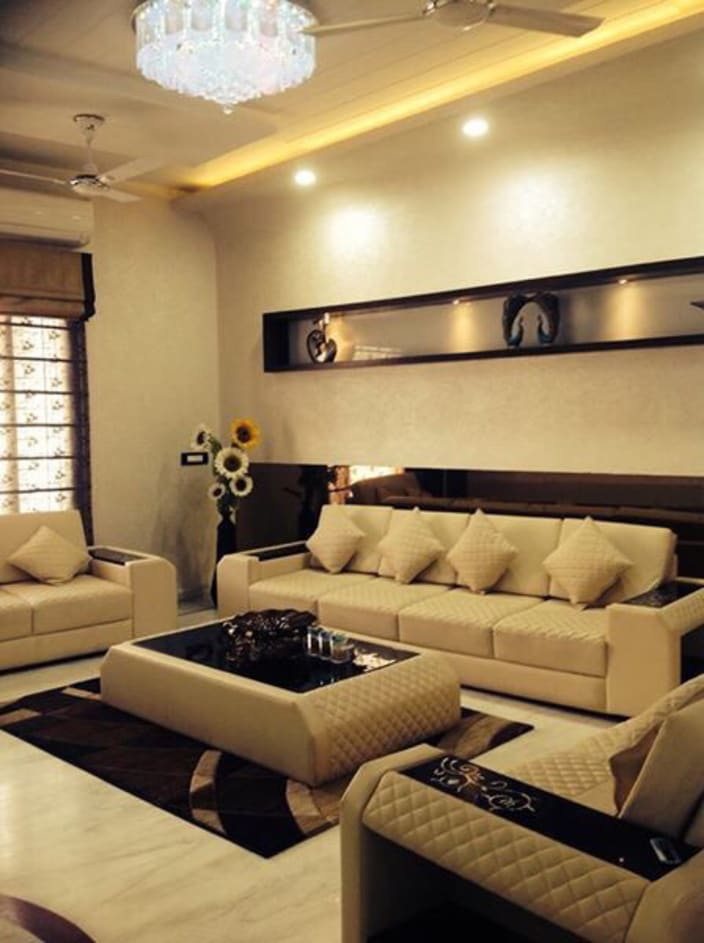 Nice Living Room With Brown Finely Stitched Sofas