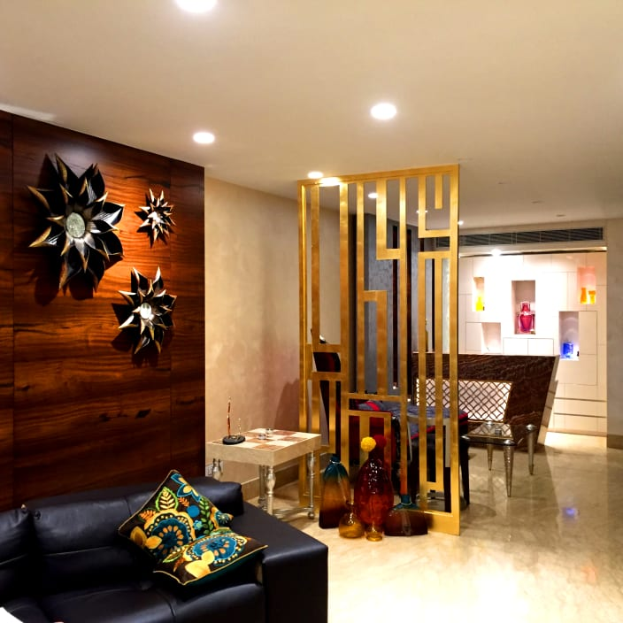 Home Interior Design Ideas Hyderabad: Lavishing Living Area With Wooden Wall Art And Black Sofa
