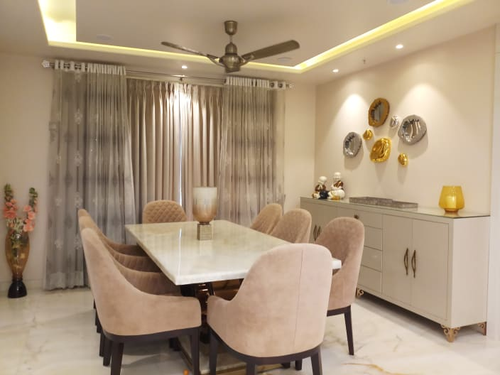 Lavish Dining Area With Beige Cushioned Chairs And White