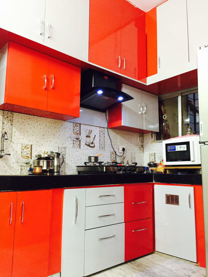 A Citrusy Twist Glossy White And Orange Themed L Shaped Kitchen Giving It A Fresh Citrus Look By Chaitanya Challa