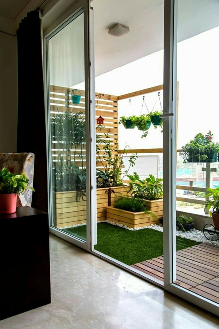 Balcony With Sliding Door And Plant Hangings