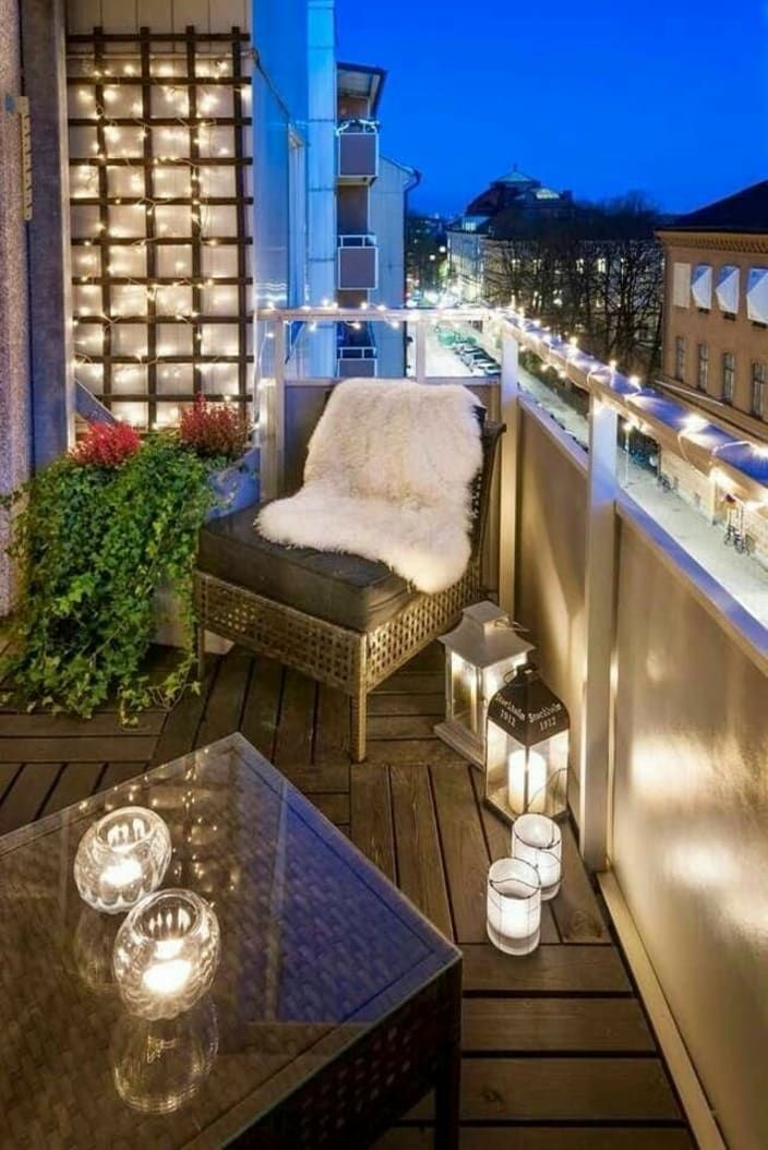 Fairy Lights, Lamps And Lounge Chair In A Contemporary Balcony