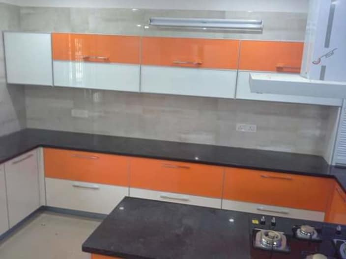 Orange Themed Kitchen With White And Orange Cabinets By Komalpreet Rekhi