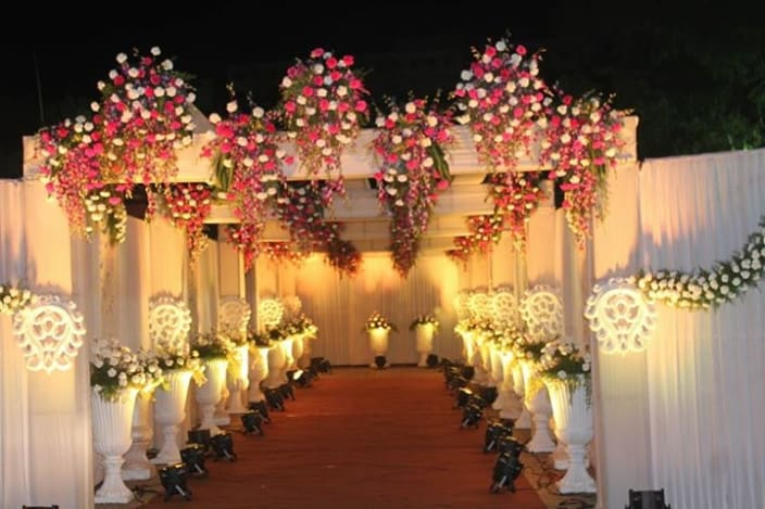 Top wedding entrance decor ideas and photos entrance with pink and white floral work junglespirit Choice Image