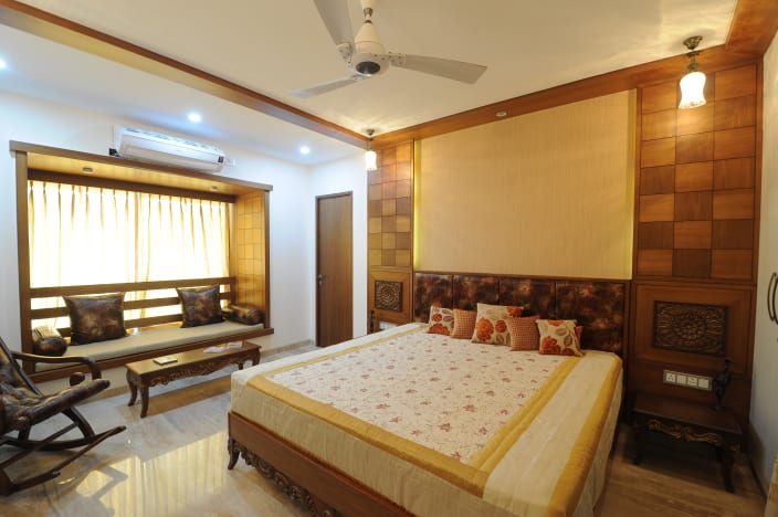 Bedroom With Woodwork On Wall And Marble Flooring By