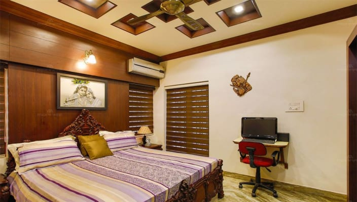 master bedroom with wooden bed and compact study table by 16129 | 1509640326366 4b752c370732055eca415774fab64e80