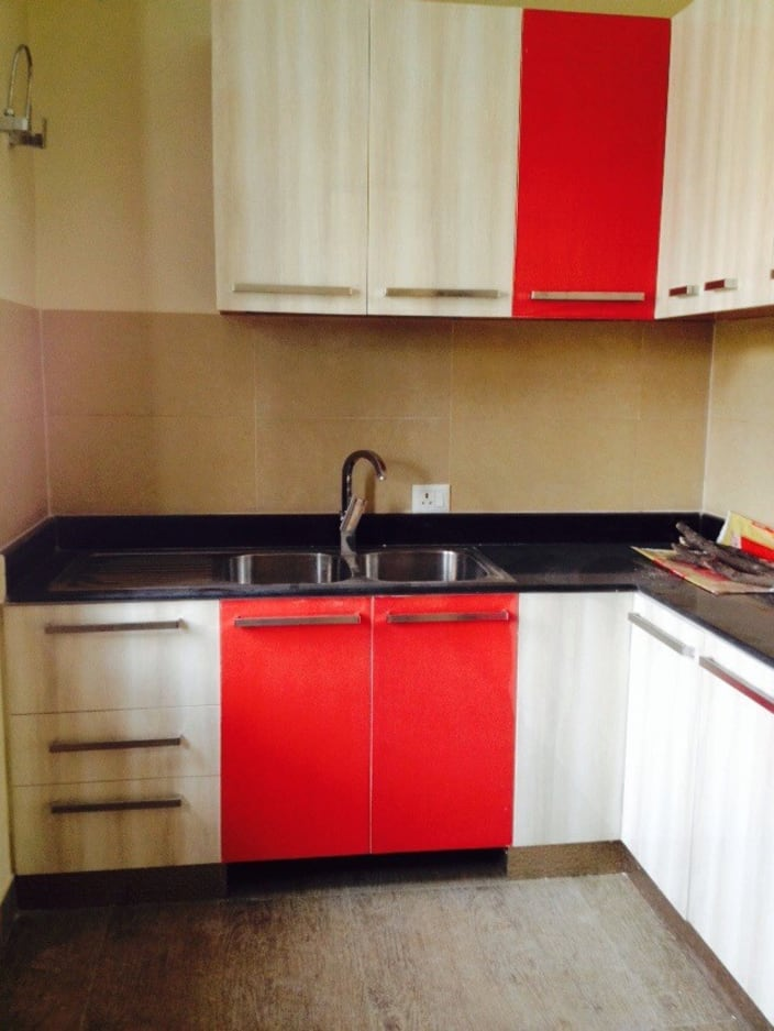 Red And White Themed Modular Kitchen With Wooden Finished Cabinets By Mauve Amp Crimson Interior
