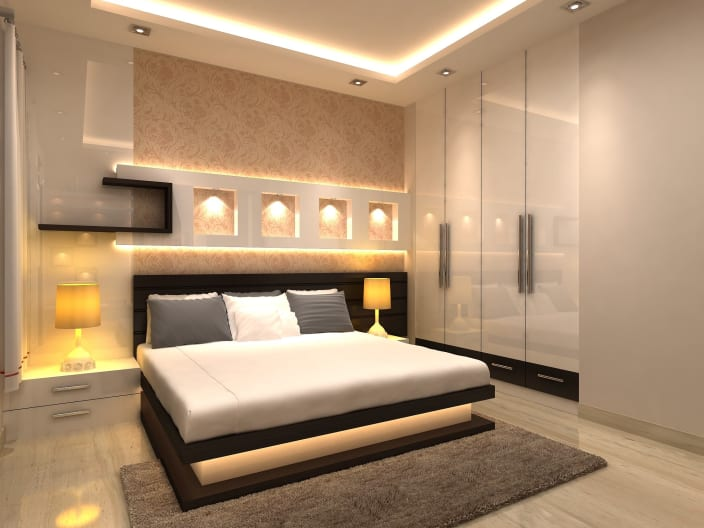 Cozy Master Bedroom With Bedside Lamp And Illuminated Backwall By Mauve Crimson Interior Solutions