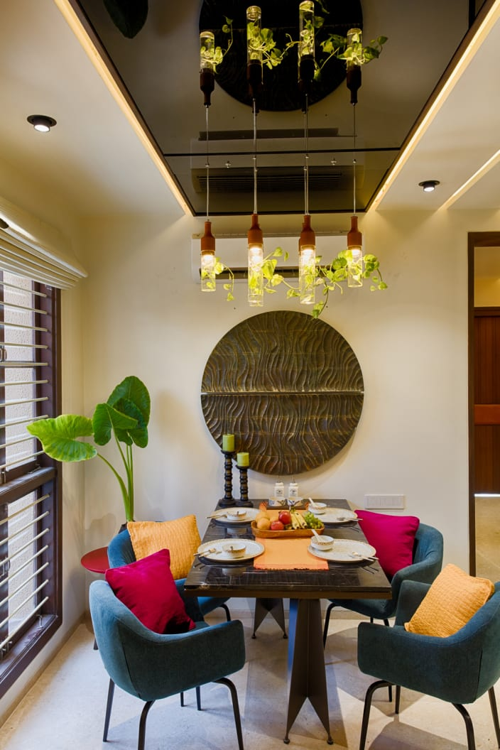Blue Chairs With Yellow Red Cushions And Rustic Pendant
