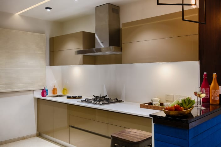 Beige Cabinets And Modern Interior Of Parallel Kitchen