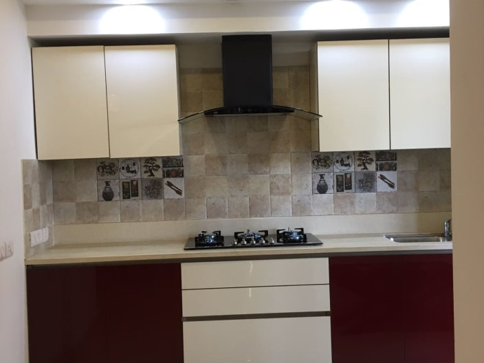 Single Counter Kitchen Withe Smart Maroon And White Cabinets And Decorative Wall Tiles By Sunil Krera