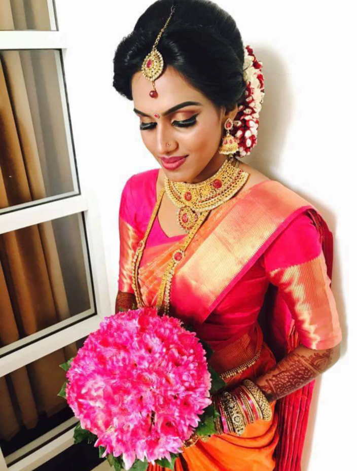 219df3573e South Indian Bridal Bun With Red And White Flowers