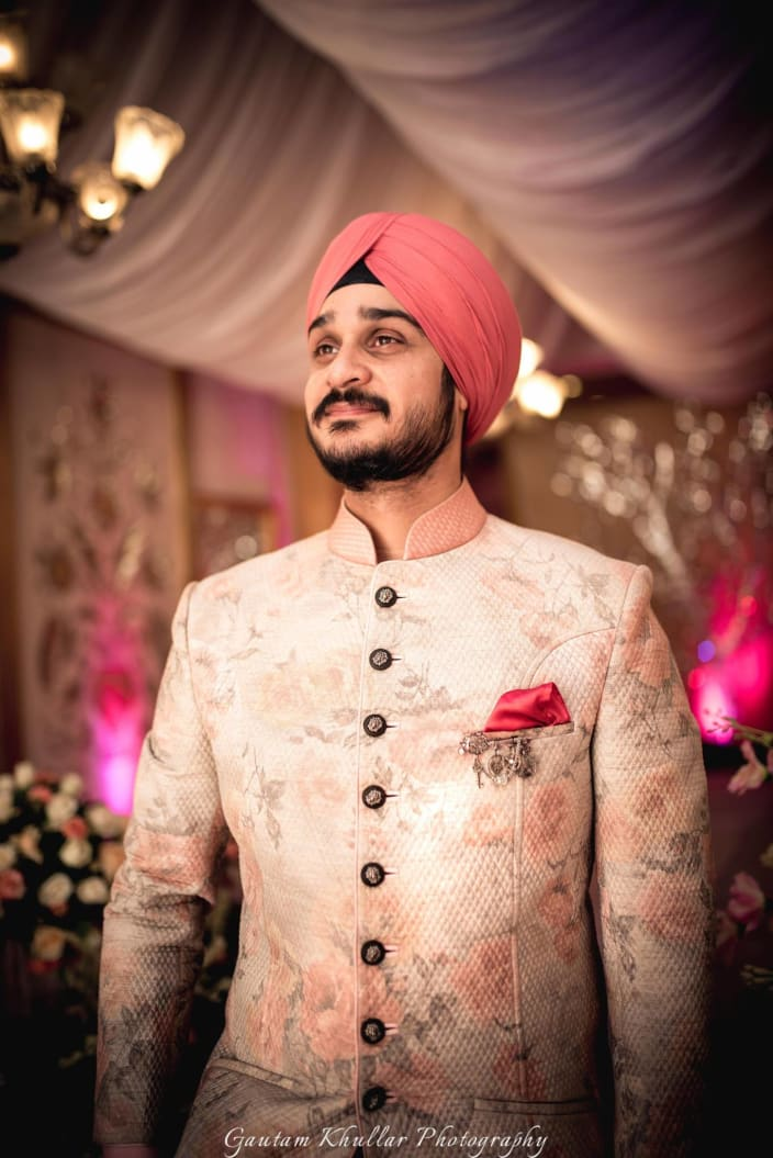 Soft Pink Flower Printed High Collared Sherwani With Black Circular Buttons And Pocket Square