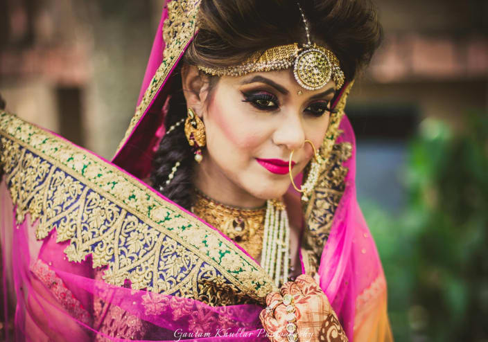 Bold Bridal Makeup With Soft Tones Pink And Majestic Matha Patti With Pearl Hangings