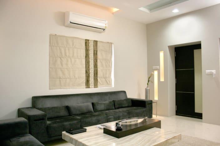 Floral White Living Room With Black Velvet Sofa By Shalini Mendiratta