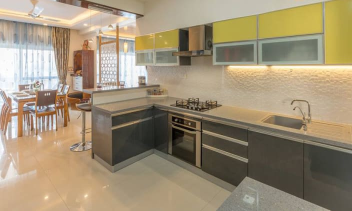 Grey Modular Kitchen With Yellow Cabinets by Kiran ...