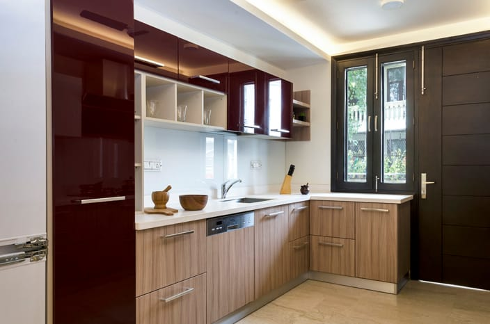 Brown L Shaped Kitchen And Maroon Cabinets