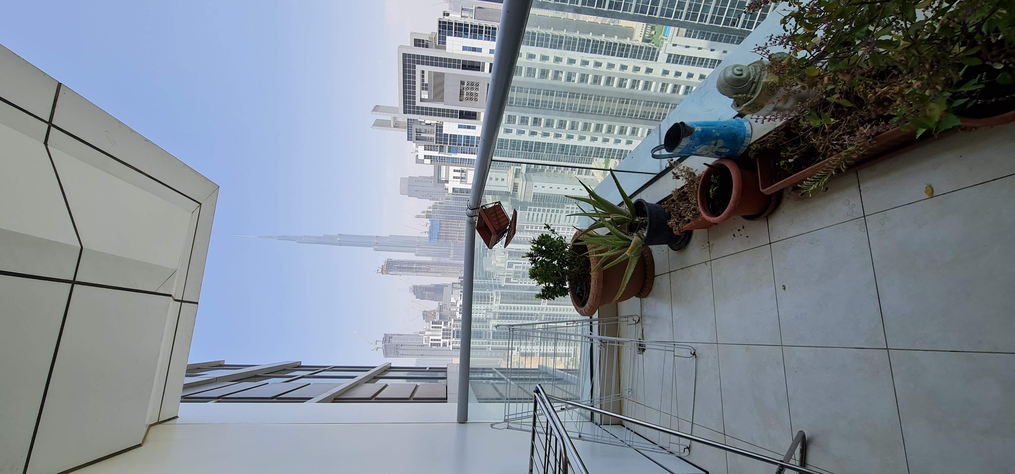 Semi Furnished & Upgraded 2BR + Maid Burj View