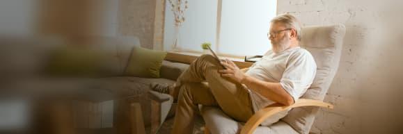 Reading-Man-on-Tablet