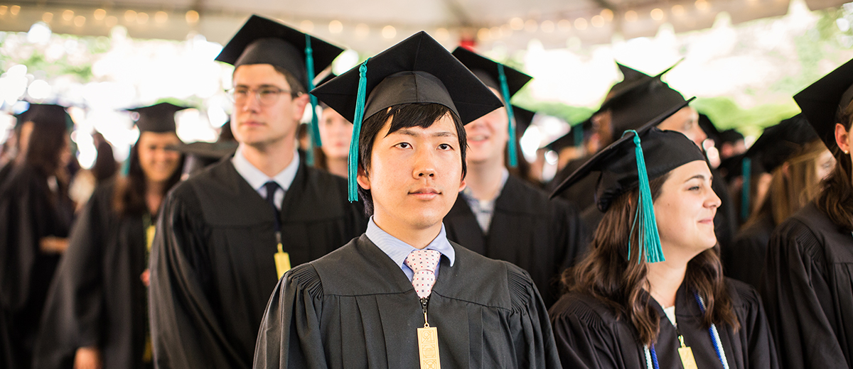 student standing at a graduation ceremony