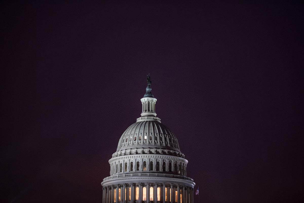 The sun sets on the U.S. Capitol on Jan. 12. (Jabin Botsford/The Washington Post)