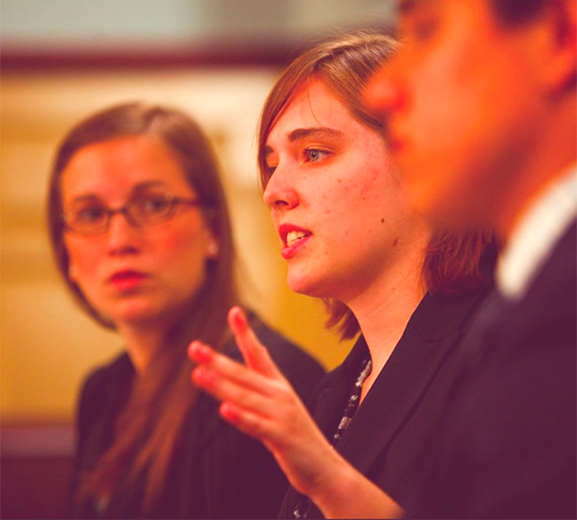 Woman student speaking to a group