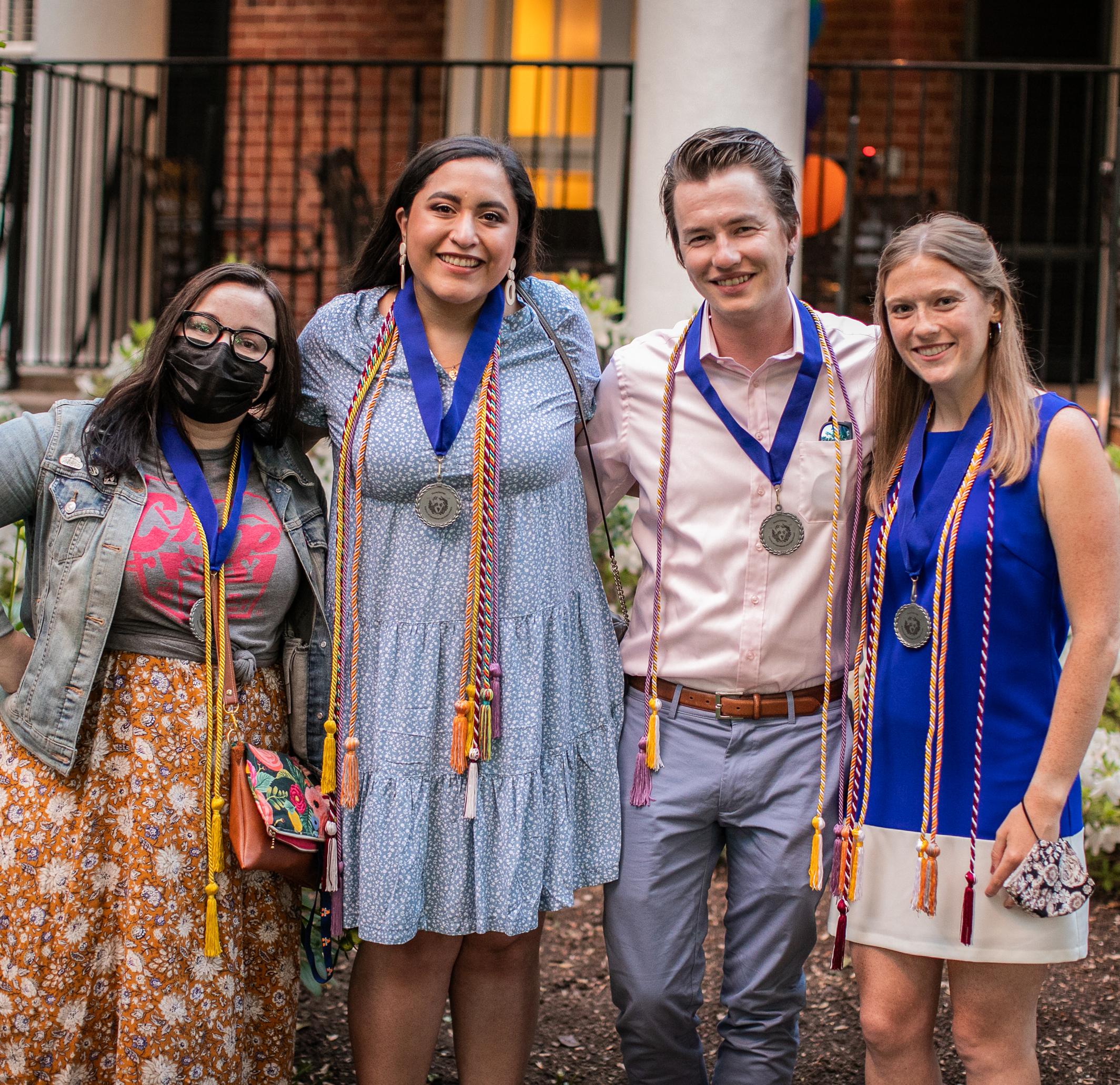 Four 2021 Batten Graduates smiling together