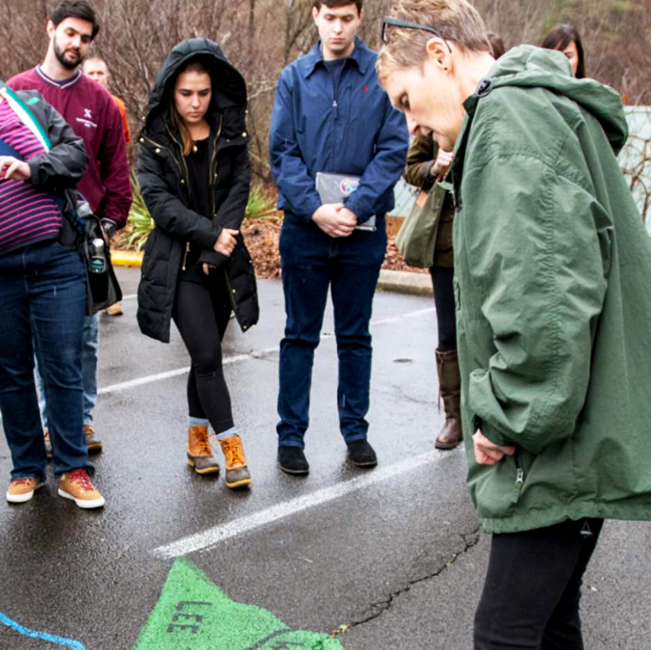 Students standing around looking at a map