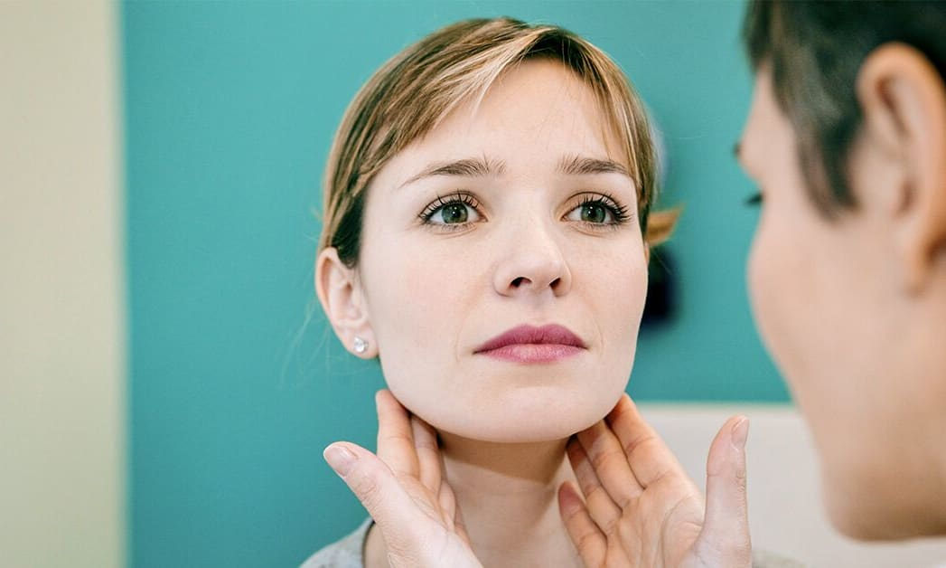 Provider checking patients thyroid
