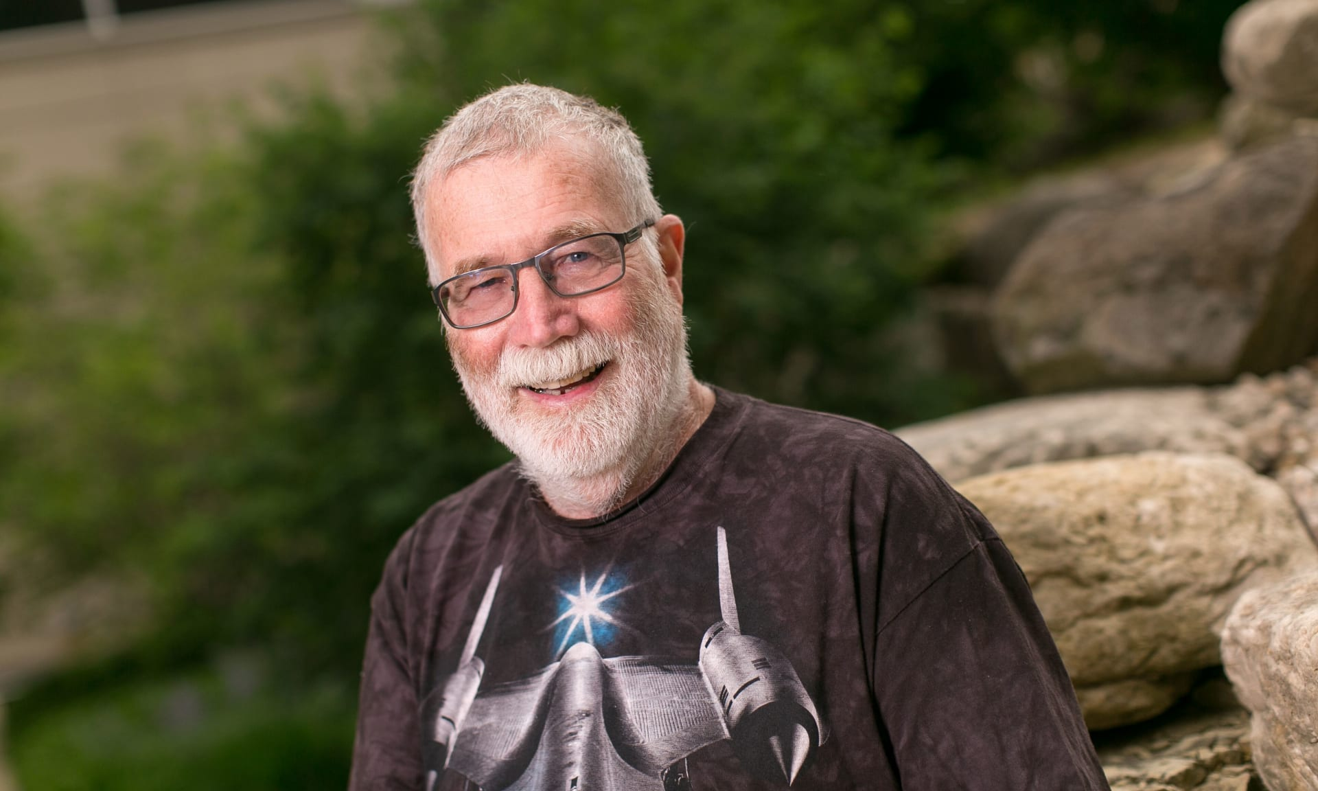 Bearded man outdoors smiling