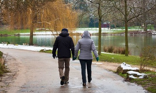Couple holding hand and walking