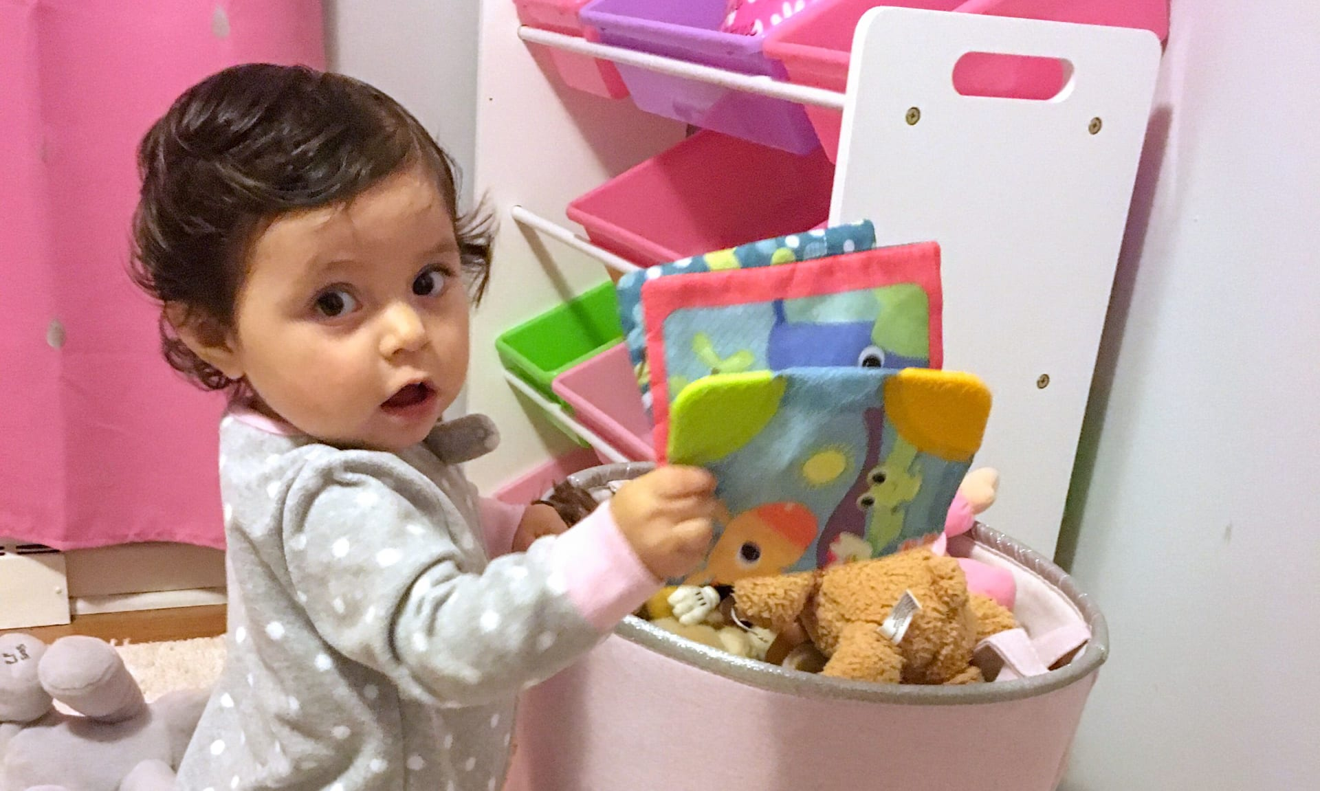 Baby with basket of toys