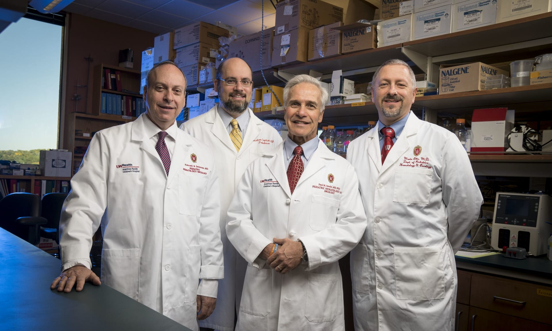 Four physicians in white coat