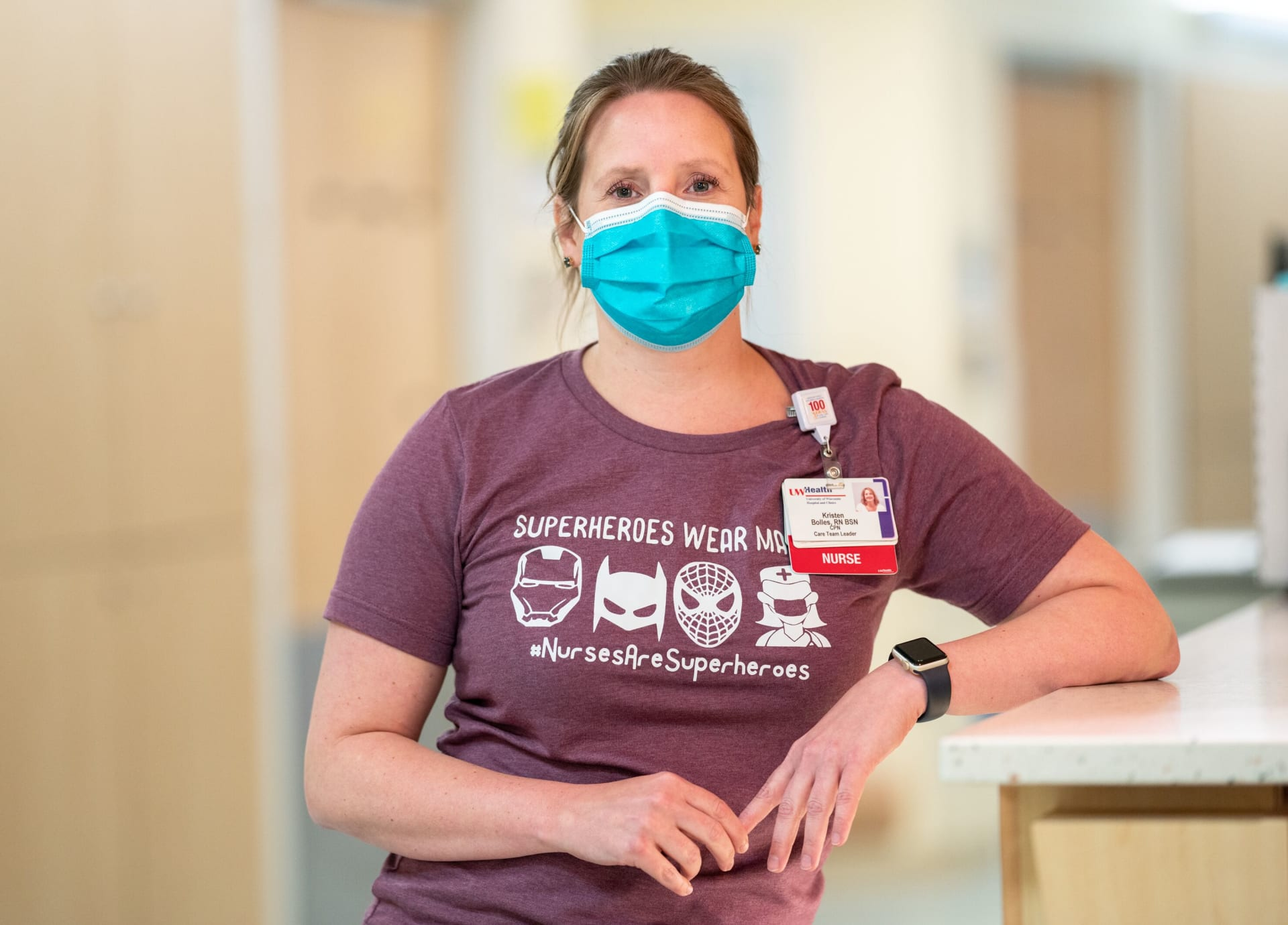 Nurse wearing a blue surgical face mask