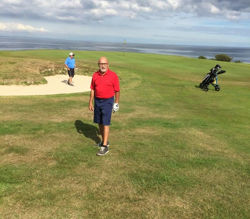 Man on golfing range