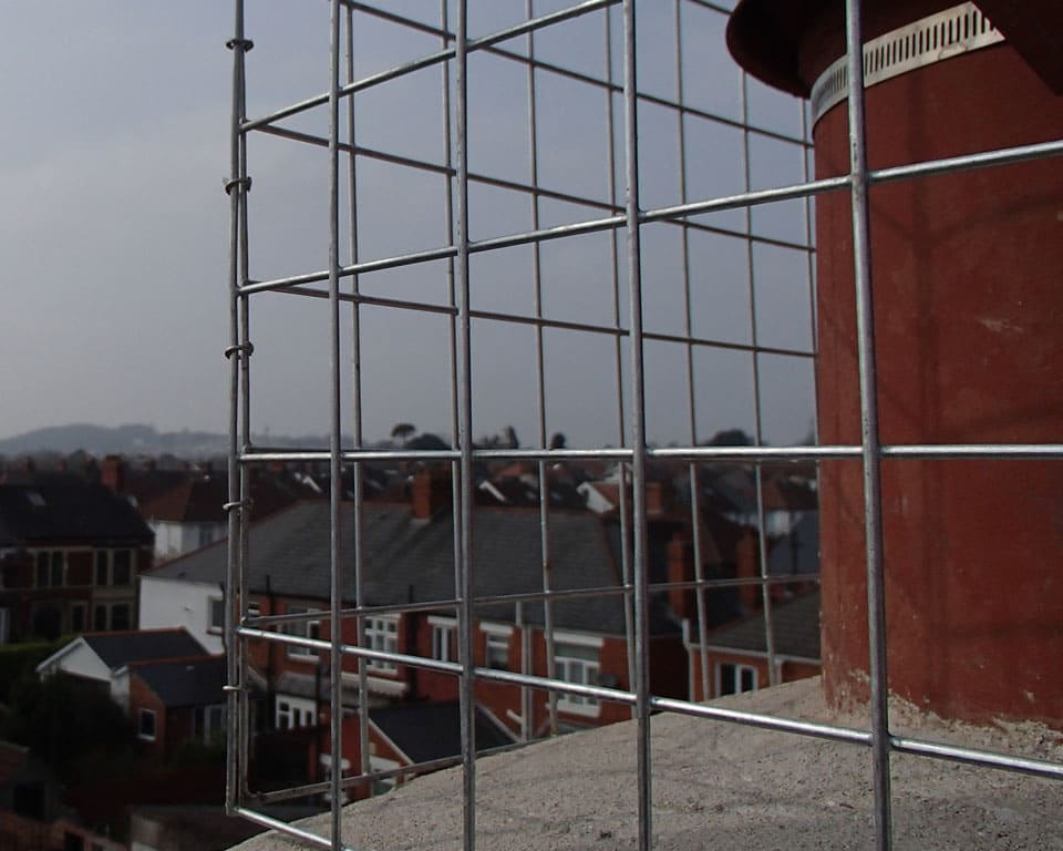 prevent gulls nesting on a chimney using stainless steel crings for chimney cage to protect against gulls