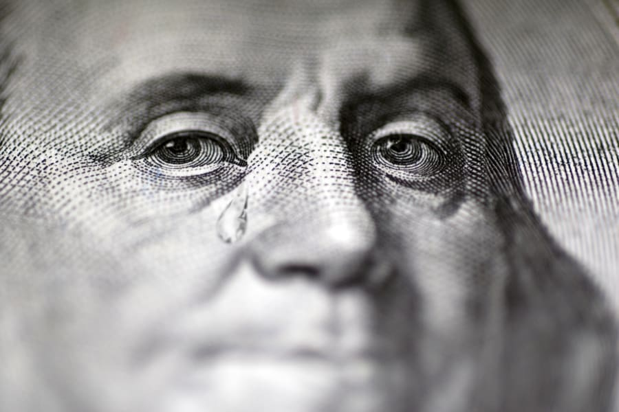 Close-up of a hundred dollar bill that is crying