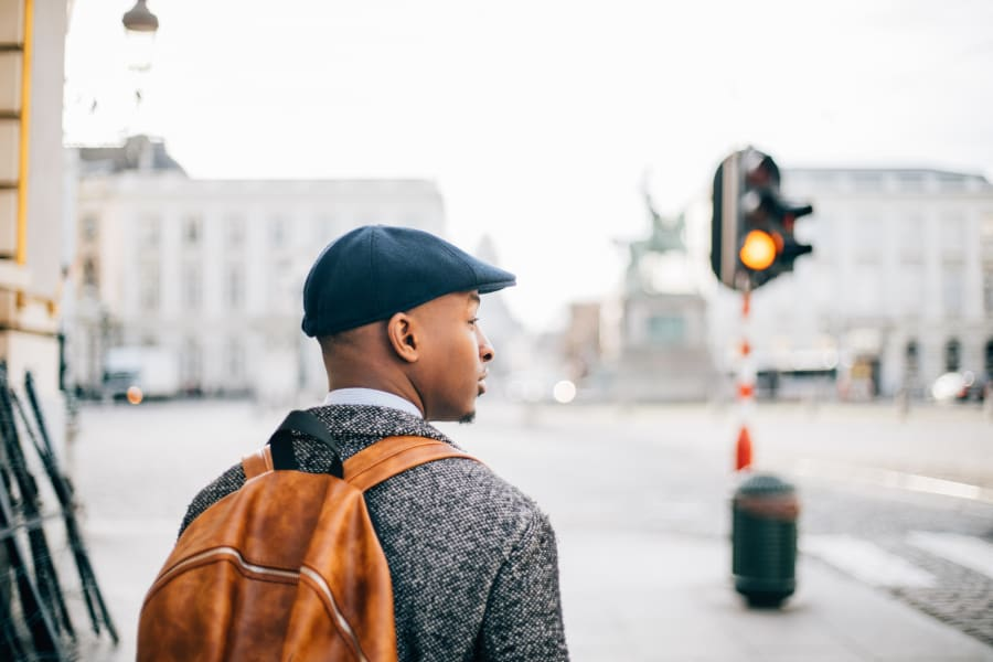 A man stands on a corner.